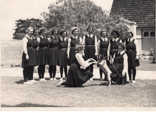 A group of girls with Patch, 1940.